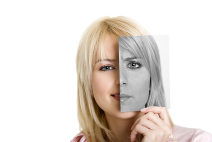 Young women with photo of her other side